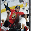 Ottawa Senators' Mike Hoffman celebrates his game winning goal against the Columbus Blue Jackets during third period NHL hockey action in Ottawa, Ontario, on Saturday, Oct. 18, 2014. (AP Photo/The Canadian Press, Sean Kilpatrick)