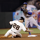 Los Angeles Dodgers second baseman Dee Gordon, top, turns a double play over San Francisco Giants' Buster Posey (28) on a ground ball by Michael Morse during the sixth inning of a baseball game on Wednesday, April 16, 2014, in San Francisco The Associated