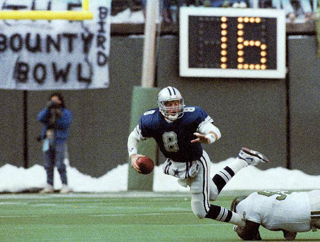 ** FILE ** In this Dec. 10, 1989, file photo, Dallas Cowboys' quarterback Troy Aikman is unable to get a pass off as he is tackled by Philadelphia Eagles' Reggie White during the first half of NFL football game in Philadelphia. The Eagles-Cowboys game on Thanksgiving in 1989 was known as the