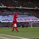 A banner in memory of the victims of the Munich Air disaster of 1958 is held above Manchester United supporters before the English Premier League soccer match between Manchester United and Leicester at Old Trafford Stadium, Manchester, England, Saturday J