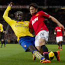 Manchester United s Shinji Kagawa, right, fights for the ball against Arsenal s Bacary Sagna during their English Premier League soccer match at Old Trafford Stadium, Manchester, England, Saturday, Nov. 10, 2013. (AP Photo/Jon Super)