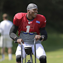 Carolina Panthers' Cam Newton smiles as he rides a stationary bike after an NFL football practice at their training camp in Spartanburg, S.C., Monday, July 28, 2014 The Associated Press