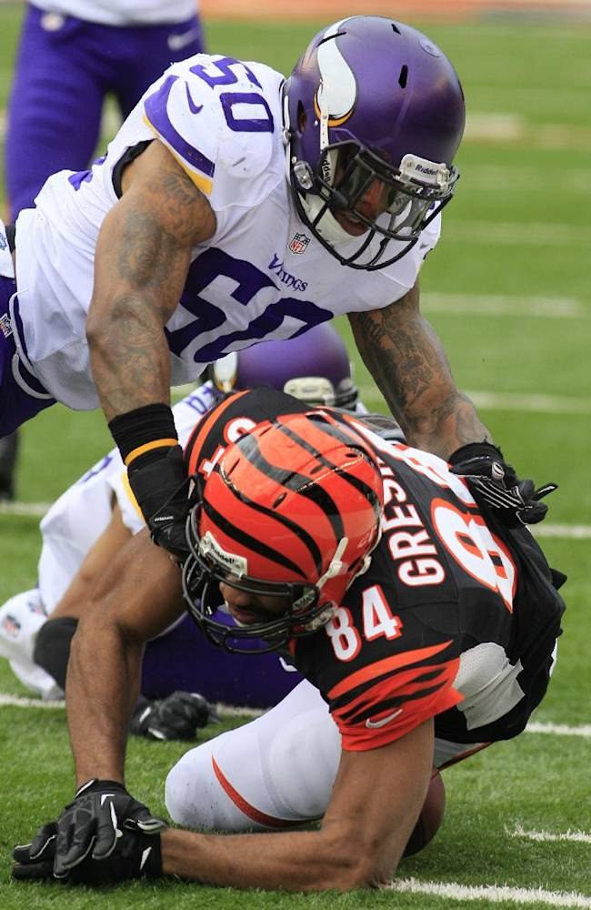 Cincinnati Bengals tight end Jermaine Gresham (84) fumbles the ball as he is hit by Minnesota Vikings middle linebacker Erin Henderson (50) in the first half of an NFL football game, Sunday, Dec. 22, 2013, in Cincinnati. Minnesota recovered the fumble