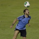 Spain's Sergio Ramos views for the ball during a training session at the soccer Confederations Cup in Fortaleza, Brazil, Monday, June 24, 2013. Spain will play one of the semifinals of the Confederations Cup against Italy on Thursday. (AP Photo/Natacha Pisarenko)