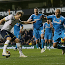 Tottenham Hotspur's Harry Kane, left, competes for the ball with Sunderland's Wes Brown, right, during the English Premier League soccer match between Tottenham Hotspur and Sunderland at White Heart Lane, London, England, Saturday, Jan. 17, 2015