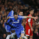 Chelsea s Gary Cahill, front centre, runs to celebrate after scoring against Southampton during their English Premier League soccer match at the Stamford bridge ground in London, Sunday, Dec. 1, 2013. Chelsea won the match 3-1