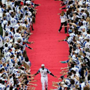Atlanta Braves' Jason Heyward smiles as he takes the field along a red carpet lined with fans before the Braves' baseball game against the New York Mets on Tuesday, April 8, 2014, in Atlanta The Associated Press