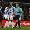 QPR's Leroy Fer speaks with referee Mike Dean after a goal was disallowed during the English Premier League soccer match between Queens Park Rangers and Manchester City at Loftus Road stadium in London, Saturday, Nov. 8, 2014