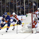 New York Islanders center Anders Lee (27) drives the puck around the boards as Florida Panthers defenseman Aaron Ekblad (5) and goalie Al Montoya (35) defend in the second period of an NHL hockey game at Nassau Coliseum on Tuesday, Feb. 3, 2015, in Uniond