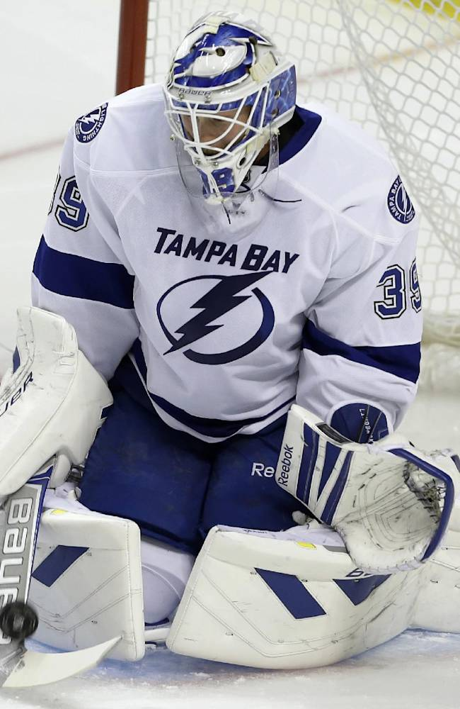 Tampa Bay Lightning goalie Anders Lindback (39) makes a save in the second period during a preseason NHL hockey game against the Florida Panthers, Saturday, Sept. 28, 2013, in Sunrise, Fla