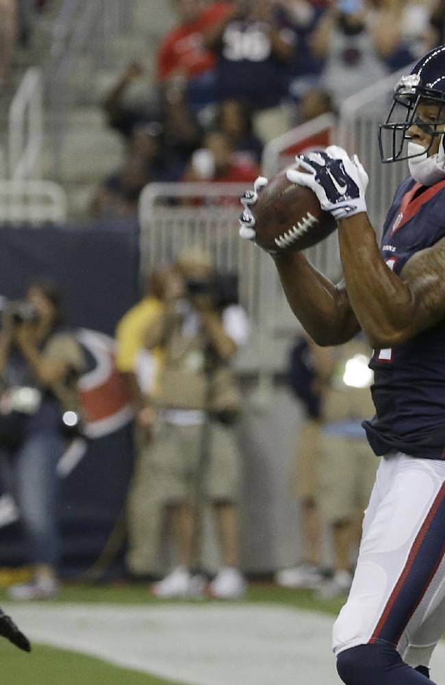 Houston Texans' DeVier Posey (11) catches a pass for a touchdown over Atlanta Falcons' William Moore (25) during the second quarter of an NFL preseason football game Saturday, Aug. 16, 2014, in Houston