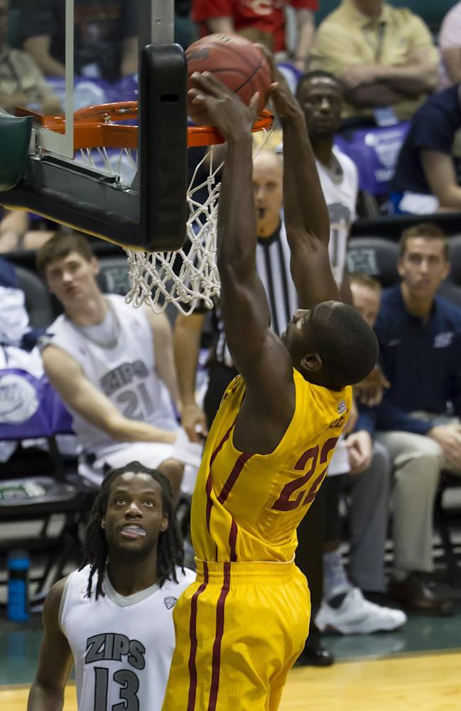 Iowa State forward Dustin Hogue (22) dunks the ball as Akron forward Quincy Diggs (13) looks on in the first half of an NCAA college basketball game at the Diamond Head Classic, Monday, Dec. 23, 2013, in Honolulu