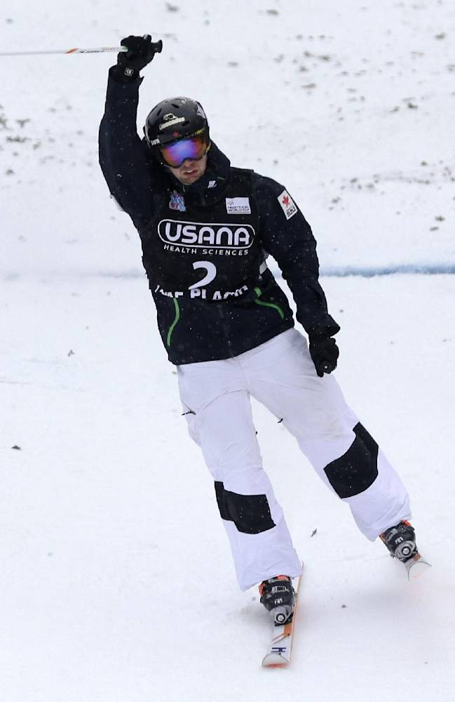 Canada's Alex Bilodeau celebrates his win in the men's freestyle World Cup moguls event Wednesday, Jan. 15, 2014, in Wilmington, N.Y