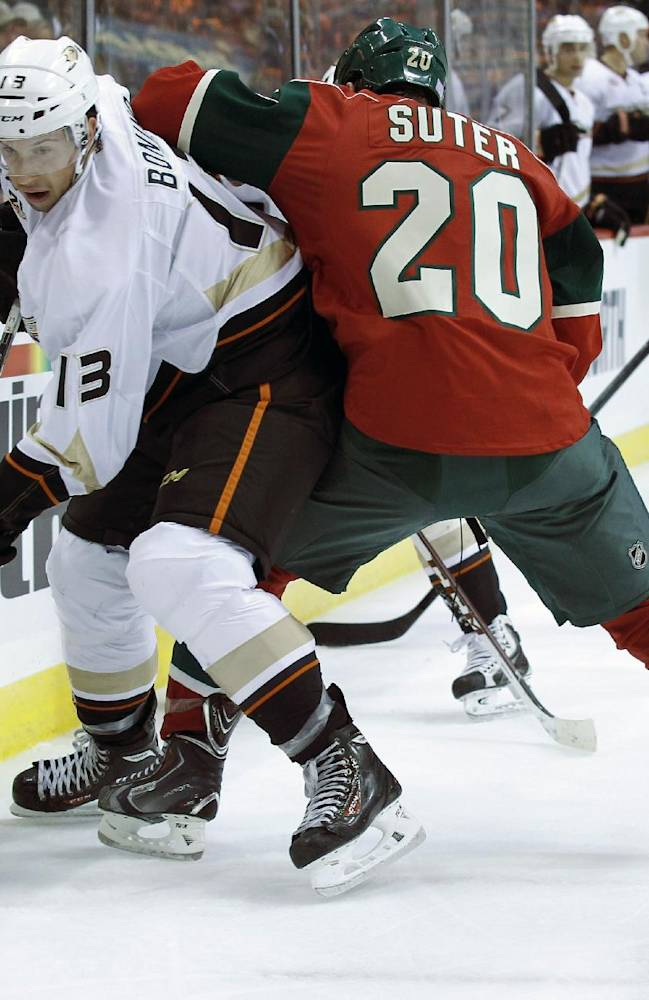 Anaheim Ducks center Nick Bonino (13) becomes entangled with Minnesota Wild defenseman Ryan Suter (20) as they battle for the puck during the second period of an NHL hockey game in St. Paul, Minn., Saturday, Oct. 5, 2013. Wild center Zenon Konopka (28) looks on. The Ducks defeated the Wild 4-3 in overtime