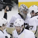 Pittsburgh Penguins' Sidney Crosby (87) congratulates goaltender Marc-Andre Fleury (29) for the Penguins' 4-2 win over the Winnipeg Jets in an NHL hockey game in Winnipeg, Manitoba, on Thursday, April 3, 2014 The Associated Press