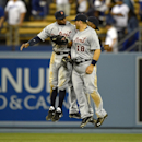 Detroit Tigers' Rajai Davis, left, Tyler Collins, center, and Austin Jackson, behind, celebrates after defeating the Los Angeles Dodgers 7-6 in a baseball game, Wednesday, April 9, 2014, in Los Angeles The Associated Press