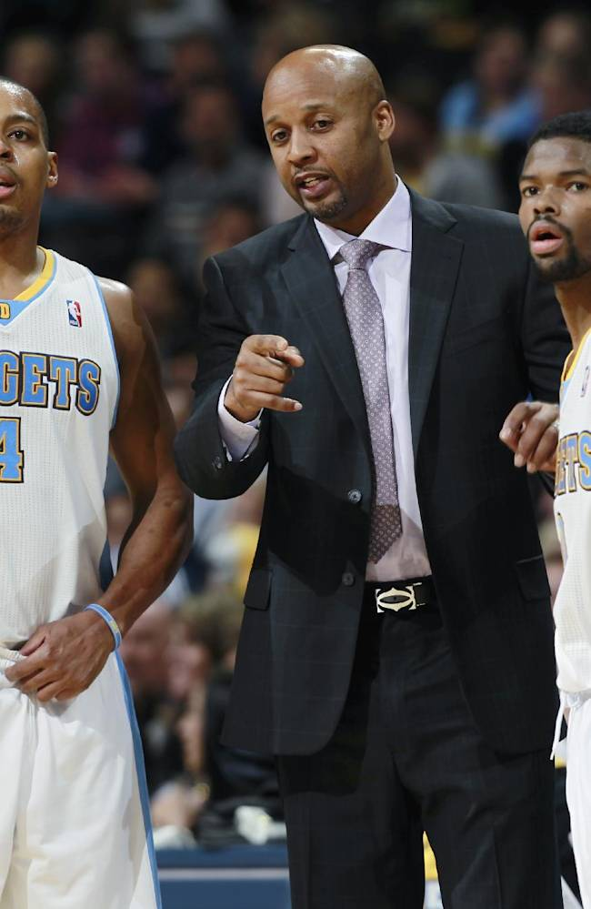 Denver Nuggets head coach Brian Shaw, center, confers with guards Randy Foye, left, and Aaron Brooks during time out against the Portland Trail Blazers in the fourth quarter of an NBA basketball game in Denver, Tuesday, Feb. 25, 2014. Portland won 100-95
