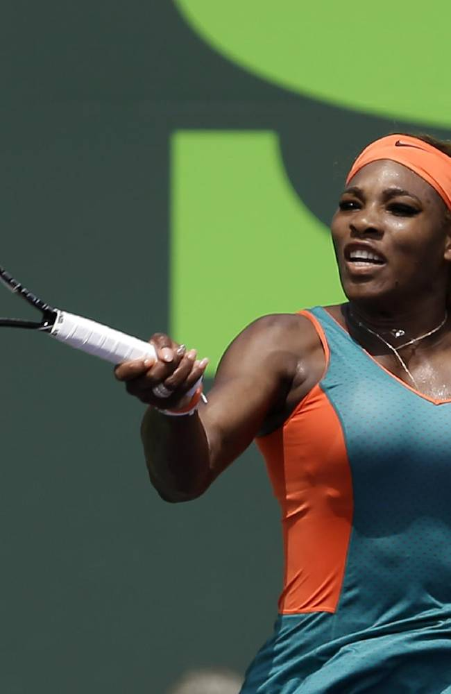 Serena Williams, of the United States, returns to Caroline Garcia, of France, during a match at the Sony Open tennis tournament in Key Biscayne, Fla., Saturday, March 22, 2014