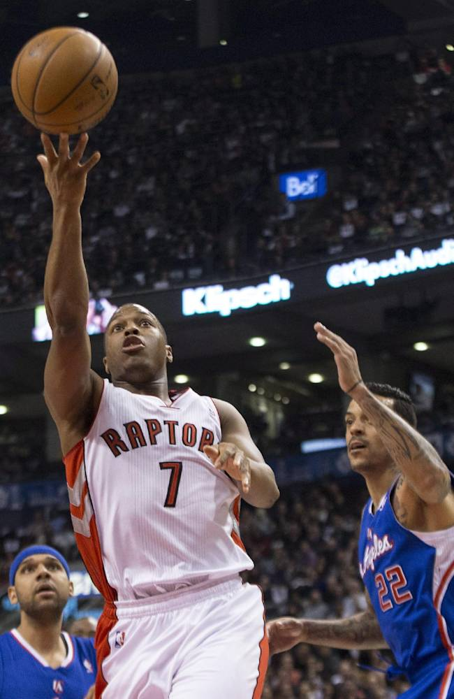 Toronto Raptors' Kyle Lowry drives through the Los Angeles Clippers defense to shoot during the first half of an NBA basketball game, Saturday, Jan. 25, 2014 in Toronto