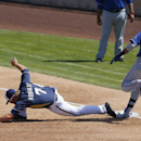 Milwaukee Brewers' Mark Reynolds (7) stretches for the ball but Texas Rangers' Engel Beltre (43) is ruled safe at first base during the second inning of a spring training baseball game, Tuesday, March 18, 2014, in Phoenix The Associated Press