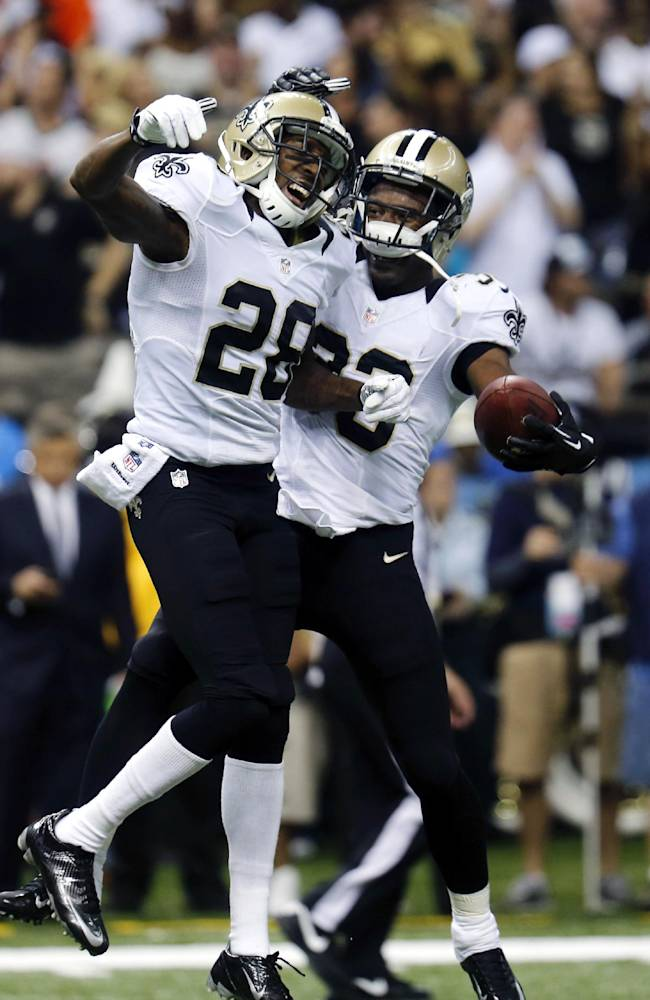 New Orleans Saints cornerback Jabari Greer, right, celebrates his interception with cornerback Keenan Lewis (28) in the first half of an NFL football game in New Orleans, Monday, Sept. 30, 2013