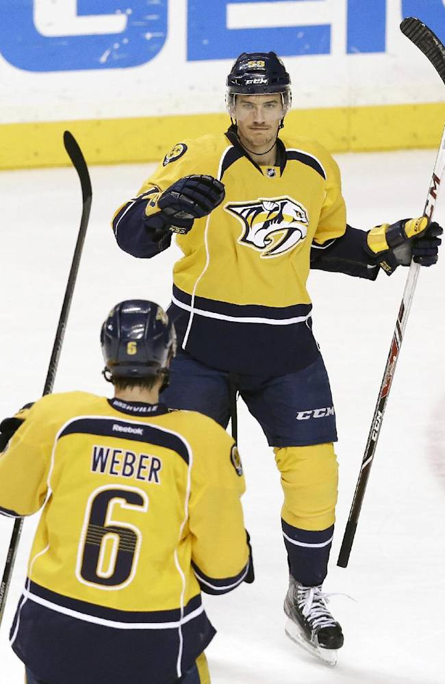 Nashville Predators defenseman Roman Josi, right, of Switzerland, celebrates with Shea Weber (6) after Josi scored against the Colorado Avalanche in the third period of an NHL hockey game, Saturday, Jan. 18, 2014, in Nashville, Tenn. The Avalanche won 5-4