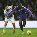 QPR's Steven Caulker, left, challenges for the ball with Manchester City's Yaya Toure during the English Premier League soccer match between Queens Park Rangers and Manchester City at Loftus Road stadium in London, Saturday, Nov. 8, 2014
