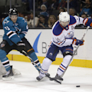 Edmonton Oilers right wing Jordan Eberle (14) skates past San Jose Sharks defenseman Justin Braun (61) during the second period of an NHL hockey game Tuesday, Dec. 9, 2014, in San Jose, Calif The Associated Press