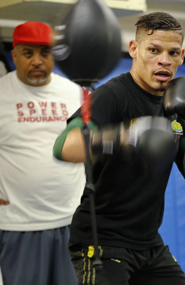 In this Sept. 24, 2013 file photo, boxer Orlando Cruz, right, works out at Mendez Boxing Gym, in New York. Cruz won the big fight of his life outside the ring when he came out as the first openly gay boxer. Now he fights for a championship Saturday night, Oct. 12, in the biggest fight of his boxing career