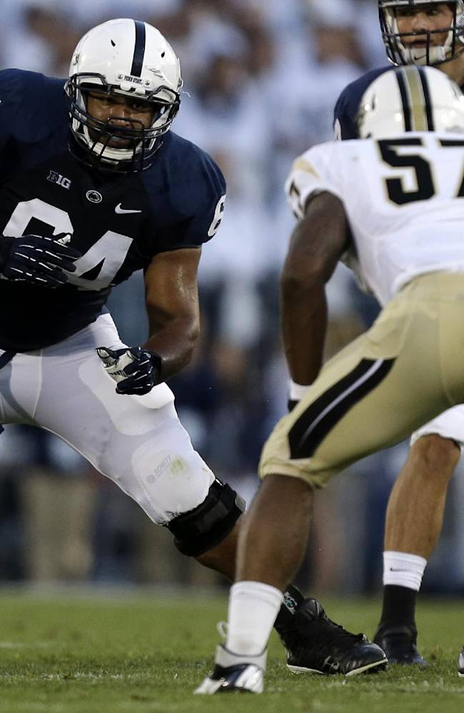 This Sept. 14, 2013 file photo shows Penn St guard John Urschel (64) playing during the first quarter of an NCAA college football game against UCF  in State College, Pa. During an outstanding career at Penn State, Urschel was one of the most accomplished multitaskers in college sports. He earned a degree in math in three years, but is putting math on hold to focus on his career as a football player