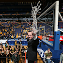 Wichita State head coach Gregg Marshall waves to fans after cutting down the net after the Missouri Valley Conference tournament championship NCAA basketball game between Wichita State and Indiana State on Sunday, March 9, 2014, at the Scottrade Center in St. Louis. (AP Photo/St. Louis Post-Dispatch, Chris Lee)