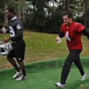 Oakland Raiders quarterback Derek Carr, right, and his teammate James Jones, left, leave the training ground following a session at Pennyhill Park, Bagshot, England, Friday, Sept. 26, 2014. The Raiders will play the Miami Dolphins in an NFL football game