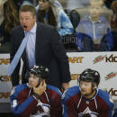 Colorado Avalanche head coach Patrick Roy, back, reacts to call against the Avalanche while facing the Florida Panthers in the second period of an NHL hockey game in Denver on Tuesday, Oct. 21, 2014. (AP Photo/David Zalubowski)