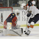 Florida Panthers goalie Roberto Luongo, left, stops a shot on the goal by forward Bobby Butler, right, during hockey training camp, Monday, Sept. 21, 2014, in Coral Springs, Fla. The Panthers play the Dallas Stars in their first preseason game of the seas