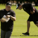 Philadelphia Eagles head coach Chip Kelly looks at notes during NFL football practice at the team's training facility, Tuesday, Sept. 30, 2014, in Philadelphia The Associated Press