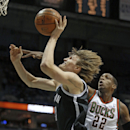 Brooklyn Nets' Andrei Kirilenko, left, puts up a shot against up against the Milwaukee Bucks' Khris Middleton (22) in the first half of an NBA basketball game, Saturday, March 1, 2014, in Milwaukee The Associated Press