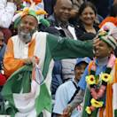 India fans watch the cricket during an ICC Champions Trophy semifinal between India and Sri Lanka at the Cardiff Wales Stadium in Cardiff, Thursday, June 20, 2013. (AP Photo/Kirsty Wigglesworth)