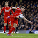 Liverpool's Steven Gerrard tries a shot on goal during the English League Cup semifinal second leg soccer match between Chelsea and Liverpool at Stamford Bridge stadium in London, Tuesday, Jan. 27, 2015