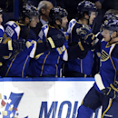 St. Louis Blues' Vladimir Sobotka (17), of the Czech Republic, is congratulated by teammates after scoring during the first period of an NHL hockey game against the Minnesota Wild on Monday, Nov. 25, 2013, in St. Louis The Associated Press