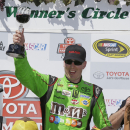 Kyle Busch celebrates after winning the NASCAR Sprint Cup Series auto race Sunday, June 28, 2015, in Sonoma, Calif. (AP Photo/Eric Risberg)