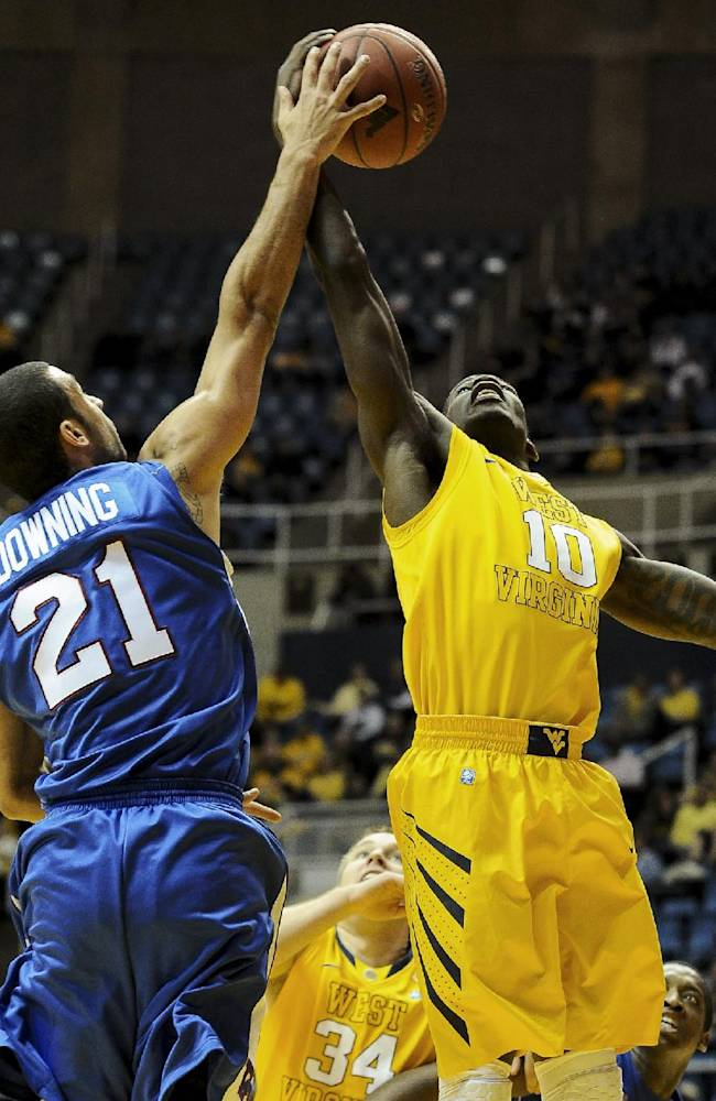 Presbyterian's Jordan Downing, left, battles West Virginia's Eron Harris (10) for a rebound during the first half of an NCAA college basketball game Saturday, Nov. 23, 2013, in Morgantown, W.Va