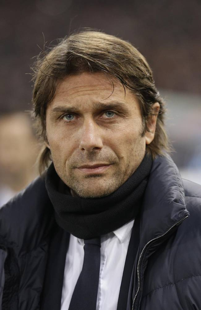Juventus coach Antonio Conte comes onto the field ahead of an Italian Cup, round of eight, soccer match, between AS Roma and Juventus at Rome's Olympic stadium, Tuesday, Jan. 21, 2014