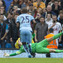 Manchester City's goalkeeper Joe Hart saves a penalty from Tottenham's Roberto Soldado, unseen, during the English Premier soccer match between Manchester City and Tottenham Hotspur at the Etihad Stadium, Manchester, England, Saturday Oct. 18, 2014