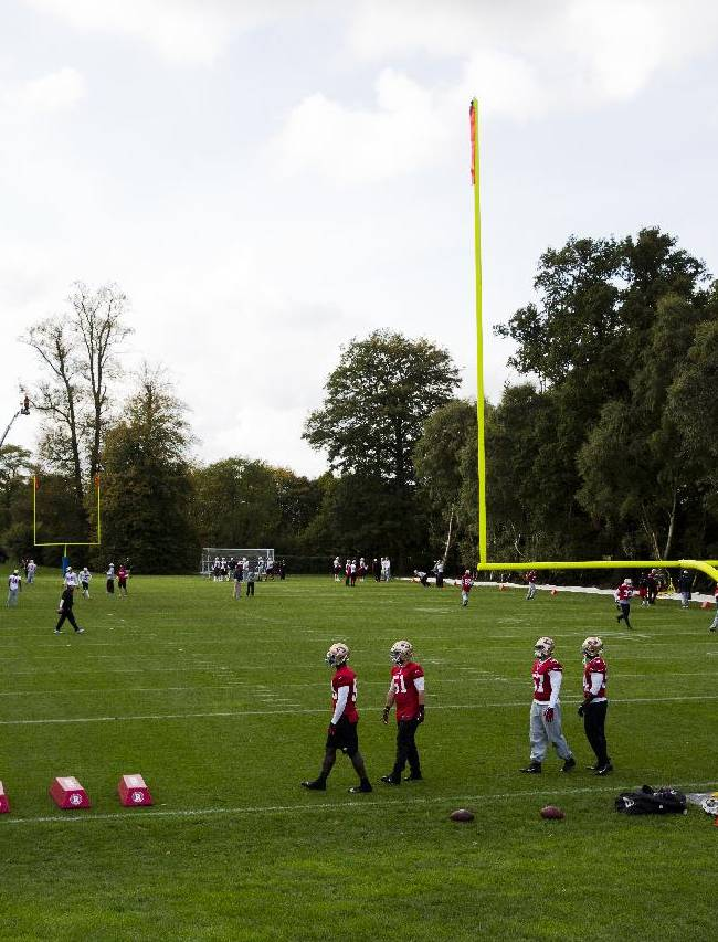 San Francisco 49ers players take part in an NFL training session at the Grove Hotel in Chandler's Cross, England, Thursday, Oct. 24, 2013.  The San Francisco 49ers are due to play the the Jacksonville Jaguars at Wembley stadium in London on Sunday, Oct. 27 in a regular season NFL game