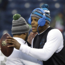 Seattle Seahawks quarterback Russell Wilson, left, greets Carolina Panthers quarterback Cam Newton before an NFL divisional playoff football game in Seattle, Saturday, Jan. 10, 2015 The Associated Press