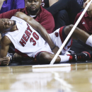 Miami Heat's Norris Cole reacts after going down with an injury during the second half of an NBA basketball game in Miami, Monday, March 3, 2014, against the Charlotte Bobcats. The Heat won 124-107 The Associated Press
