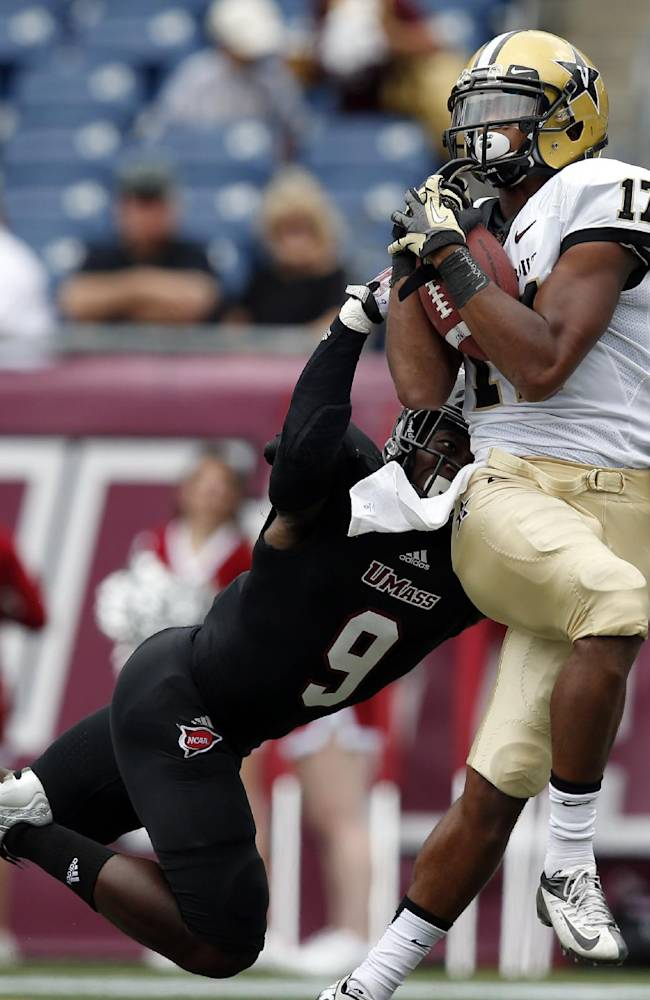 Vanderbilt wide receiver Jonathan Krause (17) catches a touchdown pass against Massachusetts defensive back Trey Dudley-Giles (9) in the first quarter of an NCAA college football game at Gillette Stadium in Foxborough, Mass., Saturday, Sept. 21, 2013