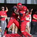Arizona safety Anthony Lopez, left, celebrates with Tra'Mayne Bondurant (21) after recovering a fumble for a touchdown during the first half of an NCAA college football game against Arizona State, Friday, Nov. 28, 2014, in Tucson, Ariz. (AP Photo/Rick Scuteri)