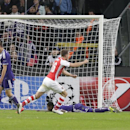Arsenal's Lukas Podolski, right, turns away after scoring the winning goal of the game during the Group D Champions League match between Anderlecht and Arsenal at Constant Vanden Stock Stadium in Brussels, Belgium, Wednesday Oct. 22, 2014. Arsenal won the