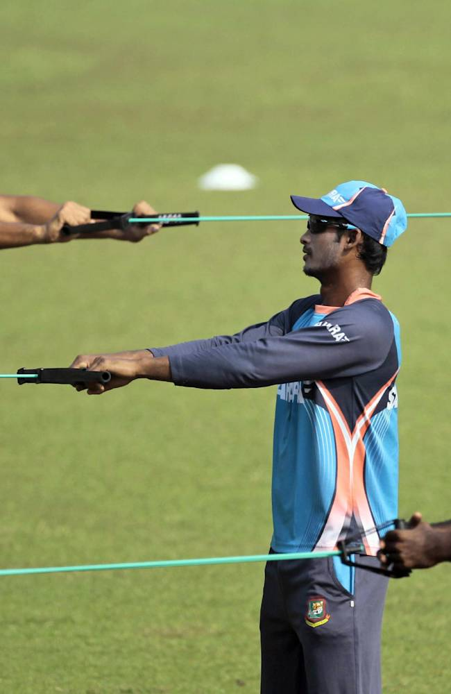 From left, Bangladesh's Mahmudullah, Naeem Islam, and Elias Sunny perform stretch exercises during a practice session a day ahead of their third one-day international cricket match against New Zealand in Dhaka, Bangladesh, Saturday, Nov. 2, 2013